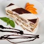 Slice of self-made italian tiramisu dessert served on a plate — Stock Photo #42612095