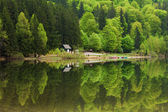Saint Ana Lake in Romania - House on a lake with reflation into — Stock Photo