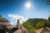 Woman relaxing in mountains — Stock Photo