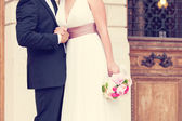 Wedding couple holding hands — Stock Photo