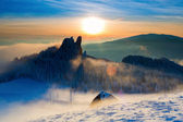 Caban in winter mountain on sunset with colorful background — Stock Photo