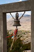 Bell against mountains — Stock Photo