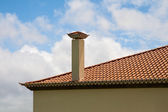 Tiled roof with a pipe — Stock Photo