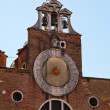 The clock on the Church in Venice — Stock Photo