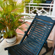 Stock Photo: Loungers on balcony