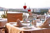 Dinner table with bay view — Stock Photo