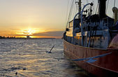Boat moored at sunset — Stock Photo