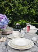 Dinning table set on the garden — Stock Photo