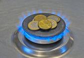 Monety euro w niebieski płomień gazu — Zdjęcie stockowe