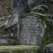 Ancient graveyard grim — Stock Photo