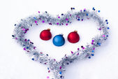 Balls in the heart on the snow — Stock Photo