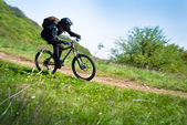 Extreme downhill cycling — Stock Photo