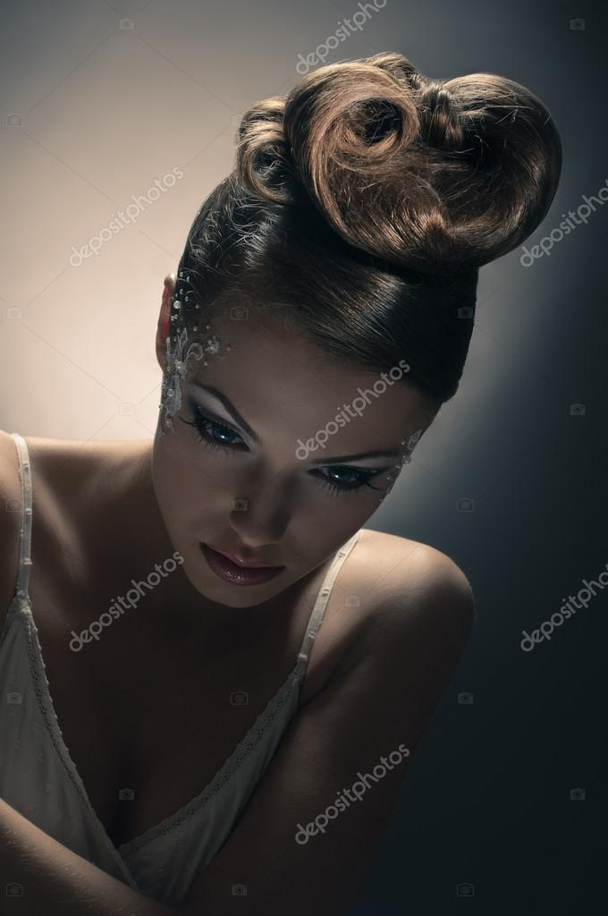 Portrait of beautiful girl bride with coiffure and make up on grey — Stock Photo #12290819