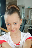 Portrait of young beauty gymnast in gymnasium — Stock Photo