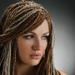 Girl with an african plaits — Stock Photo