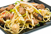 Noodles and three kinds of meat — Stock Photo