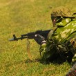 Soldier on grass — Stock Photo