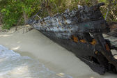 Old damaged ship on the beach — Stock Photo