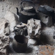 Stock Photo: Hearth with teapot and tinware. Cave at Socotrisland, Yemen