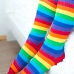Legs in striped socks stockings. — Stock Photo
