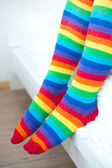 Legs in striped socks stockings. — Stock Photo