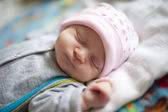 Little baby sleeping on a cot. — Stock Photo