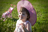 Little girl in a summer park. — Stock Photo