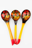Three painted wooden spoons Russian Khokhloma. — Stock Photo