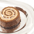 Swiss roll on the metal tray — Stock Photo