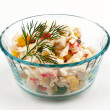 Crab salad with a sprig of dill in a glass cup - Stockfoto