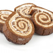 Four chocolate roll on a plate - Stockfoto
