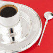 A cup of coffee on a metal tray — Stock Photo