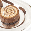 Several Swiss roll on the metal tray — Stock Photo