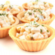 Three tartlets with salad — Stock Photo