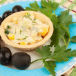 Tartlets with salad and olives - Stock Photo