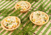 Tartlets with salad — Stock Photo