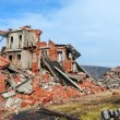 Completely ruined brick building — Stock Photo #21544589