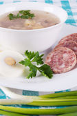 A bowl of soup and cold cuts — Stock Photo