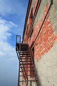 Rusty fire escape on the wall — Stock Photo