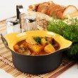 Stewed potatoes in ceramic pot. — Stock Photo #23333116