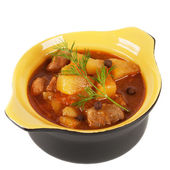 Black clay pot with braised potatoes. — Stock Photo
