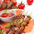 Royalty-Free Stock Photo: Shish kebab with herbs on a white plate
