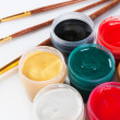 Jars with colored gouache and paint brushes. — Stockfoto