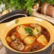 Stewed potatoes in a ceramic pot. — Stock Photo #25045369