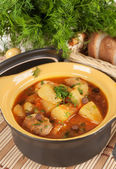 Stewed potatoes in a ceramic pot. — Stock Photo