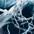 Network of cracks in thick solid layer of ice — Stock Photo #25599535
