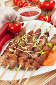 Shish kebab on bamboo sticks — Stock Photo