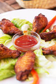 Grilled Chicken Wings with Red Spicy Sauce — Stock Photo