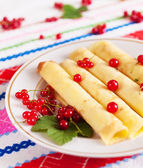 Pancakes decorated with red currant berries. — Stock Photo