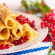Pancakes and a branch of red currants. — Stock Photo